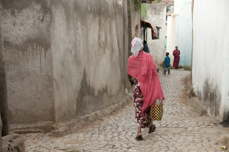 ethiopian woman walking on a street
